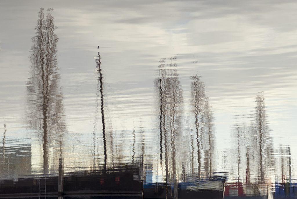 Reflectie van boten in de Marinehaven